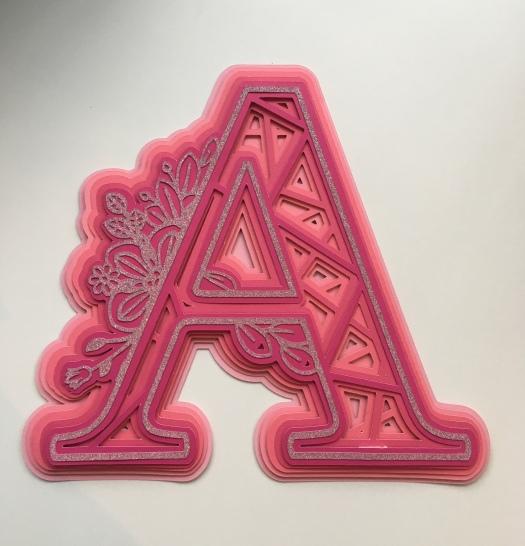 Pink letter A mandala design