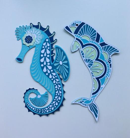 seahorse and dolphin mandala in aqua colours