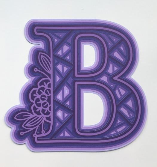 Purple letter B in mandala style